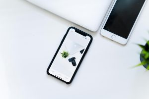 Image of phones on top of white desk